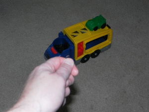 Toy truck with car on top