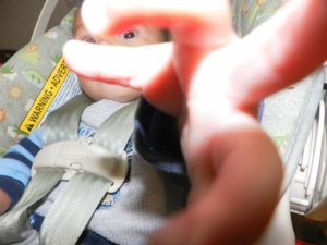 baby grabbing at camera