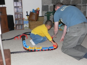Playing with trains on floor