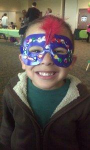 boy wearing paper mask