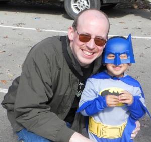 batman posing with his dad