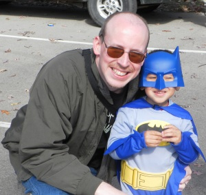 batman posing with his dad
