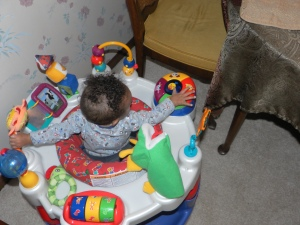 baby playing in exersaucer