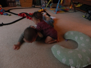 boy and baby playing on floor