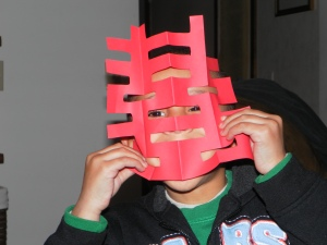 Boy wearing happiness mask