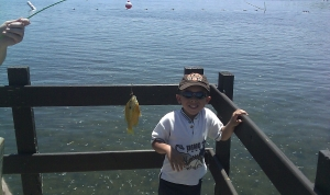 boy with first fish caught
