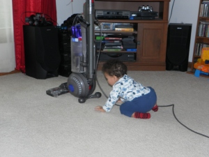 boy with vacuum cord