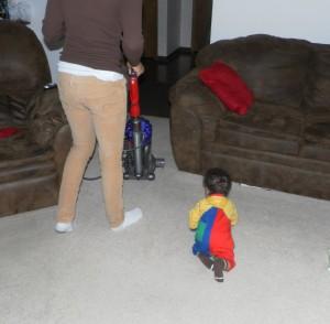 boy chasing vacuum
