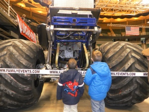kids looking at monster truck
