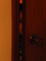 kid peeking through door crack