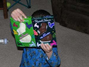 boy with chocolate bunnies