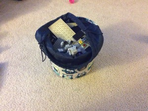 The dreaded LEGO basket/bag. It doesn't look like a lot, but underneath the three big pieces are 999,999,997 tiny pieces.