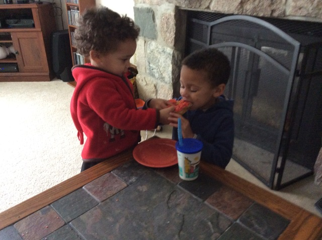 By the time I grabbed the camera the battle was mostly won.  Strawberry frosting and brotherly love are powerful foes.